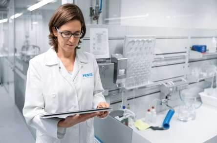 Life sciences: woman with laboratory tablet